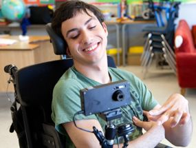 Braydon is one of many youngsters who was thrilled to received an accessible camera.