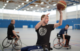 Athletes playing wheelchair basketball