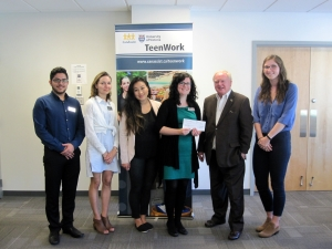 The TeenWork team accepts the cheque from Mel Cooper, chair of the TELUS Victoria Community Board