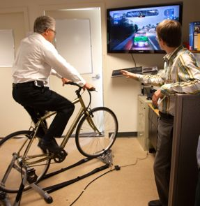 UVic's VP Research Howard Brunt tries the motivational exercise bike.