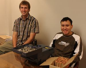 Roman (right) is a TeenWork participant who works at Recreation Oak Bay. Brian is his employment support worker.