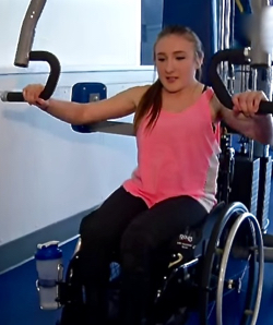 Alyshia works out on CARSA's adapted equipment.