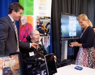 CanAssist marketing specialist Luke (seated) impresses the Countess with his iPhone system.