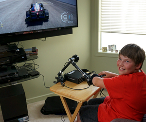 Josh is able to participate in video gaming alongside his peers, thanks to technology funded by the Norgaard Foundation.