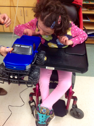 Marina, 9, received a remote control car that she can operate all by herself.