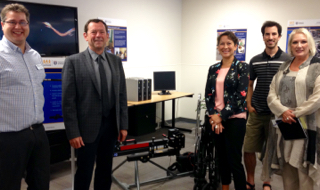 Minister Melanie (centre) gets a chance to view CanAssist technologies.