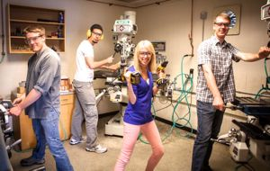 Co-op students show they are good sports during a photo shoot in CanAssist's machine shop.