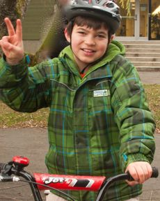 Wally, seen outside CanAssist's offices on campus, received a modified bicycle that makes it easier for him to ride.