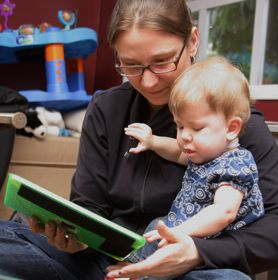 Before coming to CanAssist, Christy had to hold the iPad for Elise.