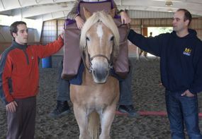 CanAssist's Andy (left) and Mike make several trips to the stables to ensure the Saddle Support is safe and comfortable.