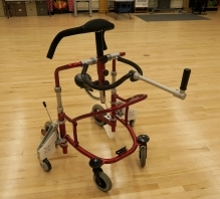 The modified gait trainer has added wheels for stability on uneven terrain.