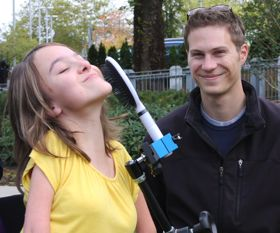 Grace can brush her own hair, thanks to the Multi-item Clamp. Brandon delivered the device to Grace during one of her visits to the BC Children's Hospital.