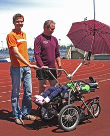 Scott (left) with Brad and Shira at the UVic track testing the modified running stroller.